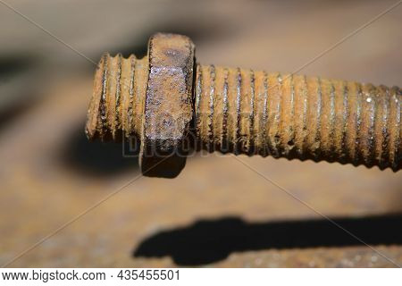 Old Rusty Bolt, Iron Rod With Screw Threads. Rusted Mechanical Components. Threaded Bolt And Nut Iso