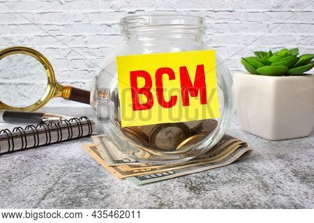 Text Bcm Business Continuity Management On The Dollars Background, Business Concept.