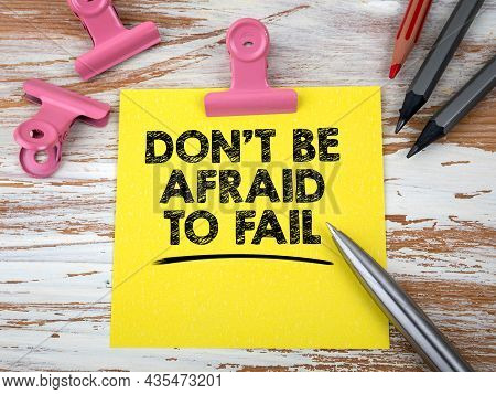 Dont Be Afraid To Fail. Notepad And Office Supplies On A Wooden Table