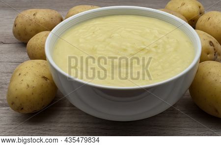 Mashed Potatoes In Small Bowl Decorated With Raw Potatoes
