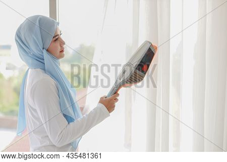 Active Young Beautiful Asian Muslim Housewife Woman Cleaning White Curtain With Vacuum Cleaning Clea