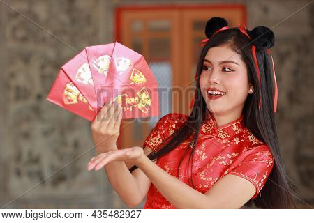 Beautiful Asian Woman In Red Chinese Dress Traditional Cheongsam Qipao With Gesture Of Showing Red E