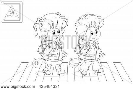 Cheerful Little Schoolboy And Schoolgirl With Backpacks Going To Their School And Crossing A Road On