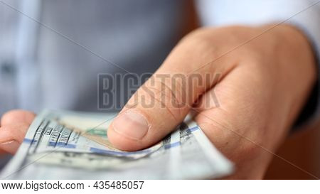 Hands Counting Us Dollar Bills Or Paying In Cash On Money Background. Concept Of Investment, Success