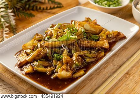 Close Up Of Bamboo Shoots And Zucchini In Spicy Sauce