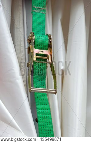 High Strength Strap With Ratchet Tying And Securing Load For Transport
