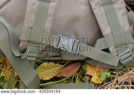 One Carbine Latch On The Harness On The Green Matter Of The Backpack