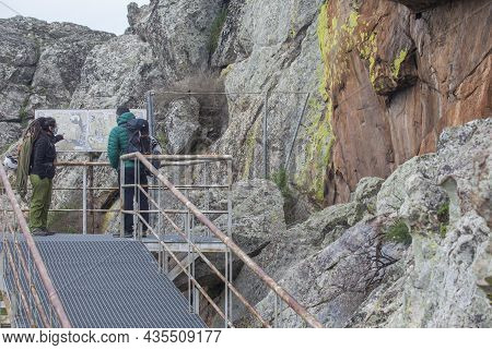 Alburquerque, Spain - Feb 21st, 2021: Visitors At San Blas Rock Shelter With Prehistorical Paintings