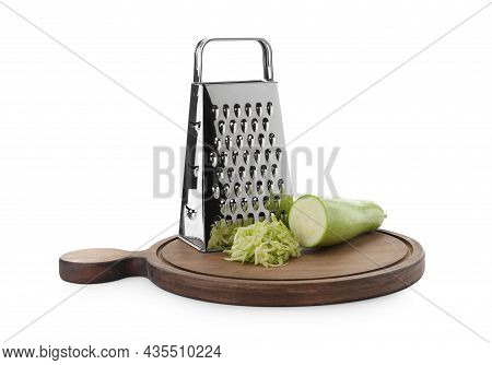 Stainless Steel Grater And Fresh Squash On White Background