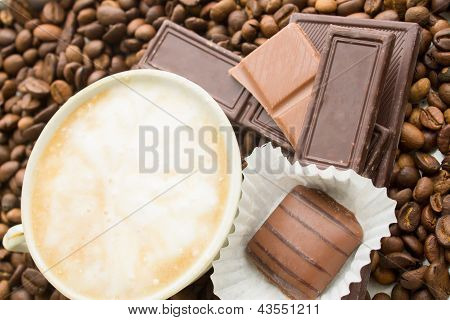 Chocolate On Coffee Beans Background