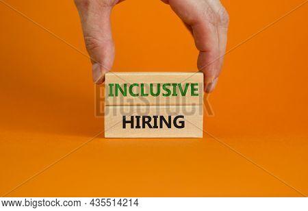 Inclusive Hiring Symbol. Wooden Blocks With Words Inclusive Hiring On Beautiful Orange Background. B