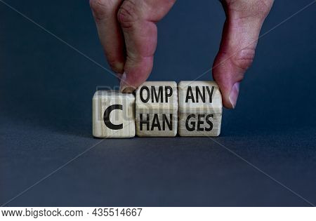 Company Changes Symbol. Businessman Turns Wooden Cubes And Changes The Word 'company' To 'changes'.