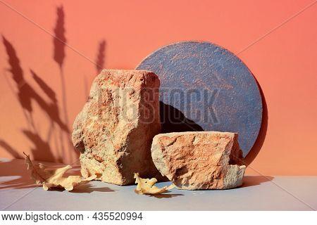 Modern Autumn Brick Podium In Orange And Grey With Natural Seasonal Fall Decor. Natural Sunlight, Lo