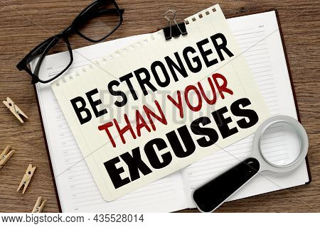 Be Stronger Than Your Excuses. Notepad Page On Notepad On Wood Table. With Place For Text. Near Offi