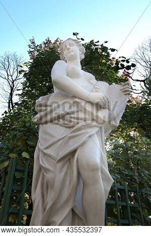 Marble Statue Of The Allegory Of Mercy In The Summer Garden, Saint-petersburg, Russia. Late Summer O