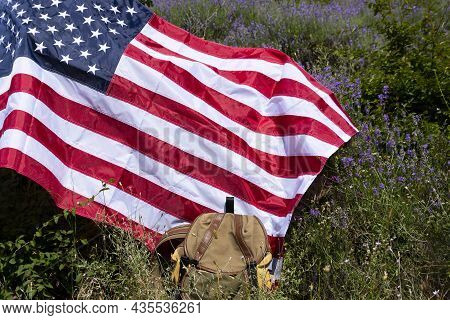 Tourist Backpack And Usa Flag On Lavender Field, No People.