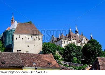 Large Old White Painted Stone Tower In The Historical Center Of The Sighisoara Citadel, In Transylva
