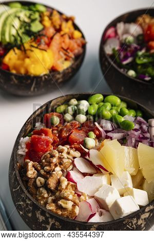 Vertical Image Close Up Of Poke Bowl With Fish, Rice And Fresh Vegetables