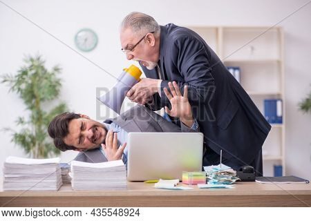 Two male employees in bullying concept