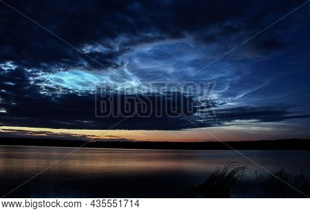 Wonderful Summer Evening And Silver Clouds, Against The Backdrop Of The Lake