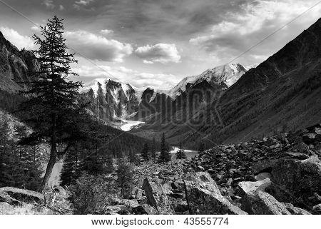 black and white  view of savlo rock face - altai range - mountains russia