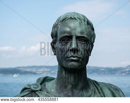 Sirmione, Italy - Ca. August 2021: Bronze Bust Statue Of Gaius Valerius Catullus  On Lake Garda
