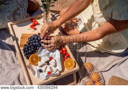 Romantic Picnic For Two With Fruit, Bread And Cheese. Oranges, Cherries, Black Grapes And Camembert