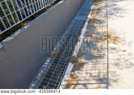 Technology View Of Outdoor Sewer Grate For Water Drainage Isolated. Greece.