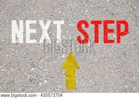 Next Steps Progress Concept With Chalk Text And Direction Arrows On Blackboard Or Chalkboard