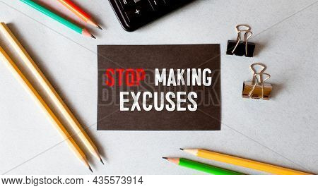 Business Concept. Notebook With Text Stop Making Excuses Sheet Of White Paper For Notes, Calculator,