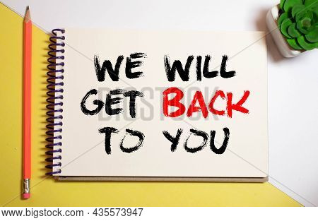 Closeup On Businessman Holding A Card With Text We Will Get Back To You, Business Concept Image With