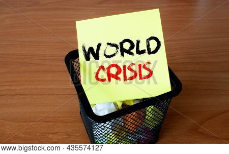 World Crisis Inscription On Paper In Female Hands.
