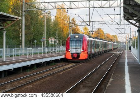 Front View Of Modern Russian Intercity High Speed Passenger Train On Railroad At Sunset, Autumn Fore