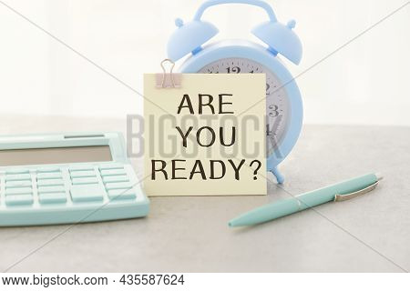 Are You Ready, Written On An Yellow Sticky Note On A Cork Bulletin Board