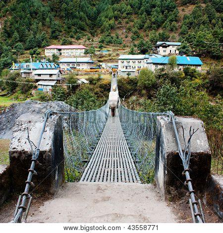 hanging footbridge ower the marsyangdi nadi river- annapurna himal - nepal