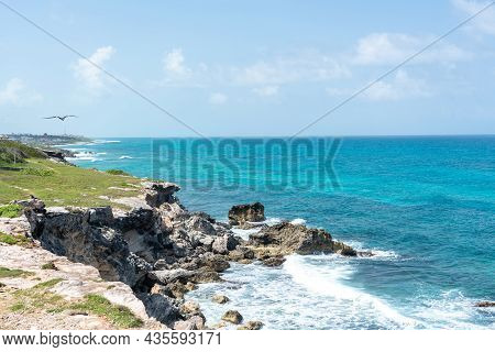 Punta Sur - Southernmost Point Of Isla Mujeres, Mexico. Beach With Rocks On Caribbean Sea