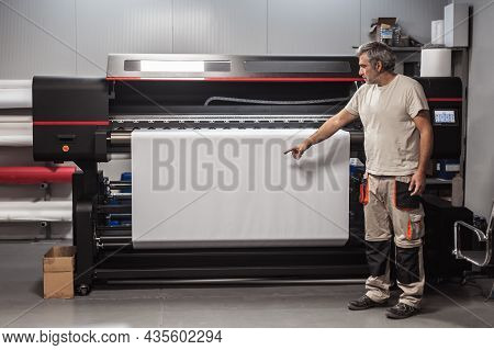 Technician Show Blank Empty Space Of Paper On Printer Plotter