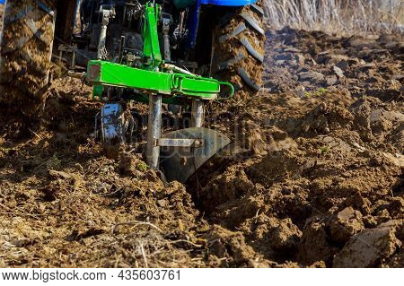 Plow The Land With The Help Of Modern Equipment, Agricultural Work On The Farm. Soil Preparation For