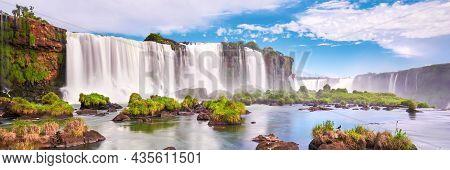 Majestic Iguazu Waterfalls In Argentina. Panoramic View Of Many Majestic Powerful Water Cascades Wit