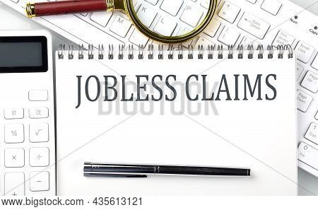 Jobless Claims . Text On Notepad With Calculator And Keyboard,business