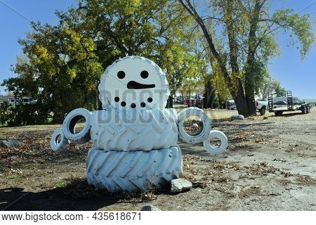 JAMESTOWN, NORTH DAKOTA - 3 OCT 2021: A Tire Snowman on the side of the road near Frontier Town.
