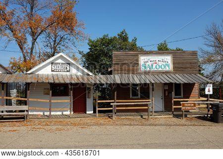 JAMESTOWN, NORTH DAKOTA - 3 OCT 2021: Sheriffs Office and The Blue Blaze Saloon on Louis L'Amour Lane in Frontier Town.