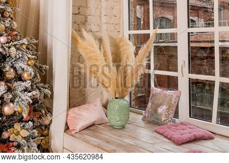Bouquet Of Pampas Grass In Green Vase On White Windowsill By The Window With Garland At Home.christm