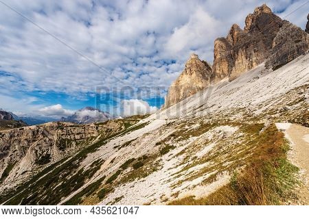 South Rock Face Of Three Peaks Of Lavaredo (drei Zinnen Or Tre Cime Di Lavaredo) And The Crystal Mou