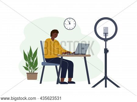 Vector Illustration Of A Male Blogger At The Table With A Laptop. Online Filming Of A Training Cours