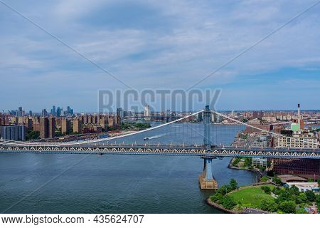 Aerial View Of The Manhattan Bridge Through The East River To District In Skyline Manhattan America.