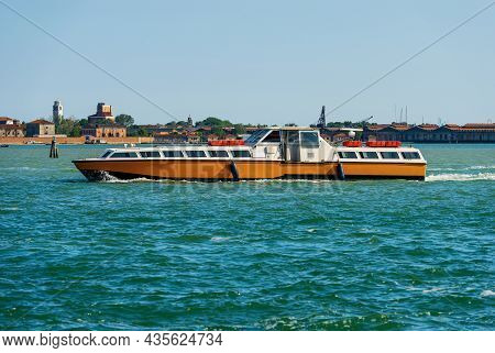 Empty Orange And White Ferry Boat Or Vaporetto In Motion In The Venetian Lagoon On A Sunny Spring Da