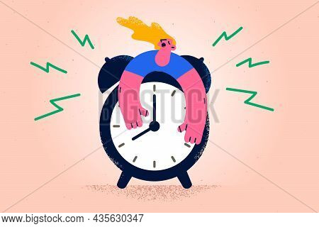 Hard Waking Up And Stress Concept. Young Stressed Sleepy Woman Embracing Huge Alarm Clock Trying To