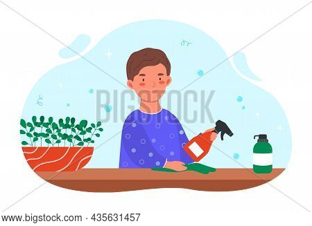Boy Cleans Table Concept. Child Sprays Cleaning Agent On Wooden Surface And Wipes Dust With Rag. Kid