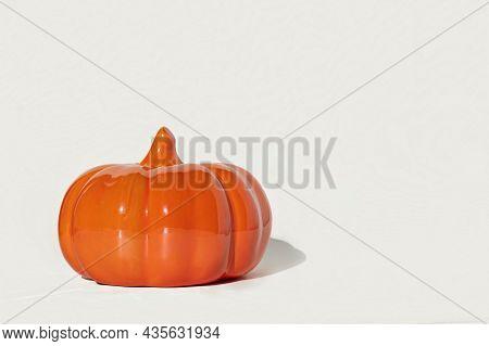 Ceramic Pumpkin On White Background. Decorative Orange Glass Pumpkin Isolated On White. Autumn Minim